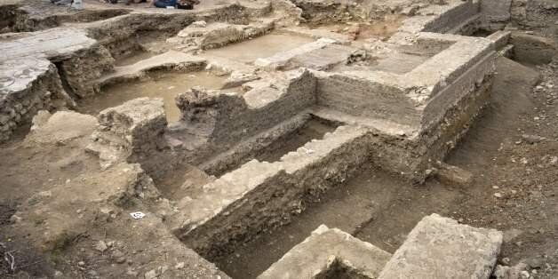 Archaeologists from Inrap (French National Institute for Preventive Archaeological Research) excavate...