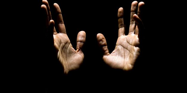 african american male hands raised to heaven in a pray (this picture has been taken with a Hasselblad...