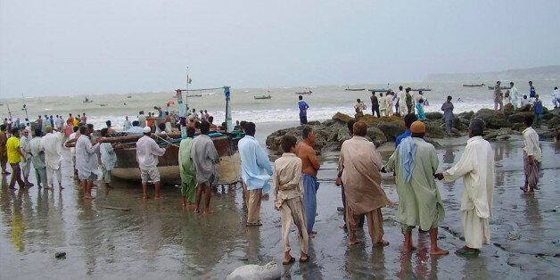 Local fisherman ground their boats to save them from cyclone Gonu in the Pakistani coastal town of Gwadar...