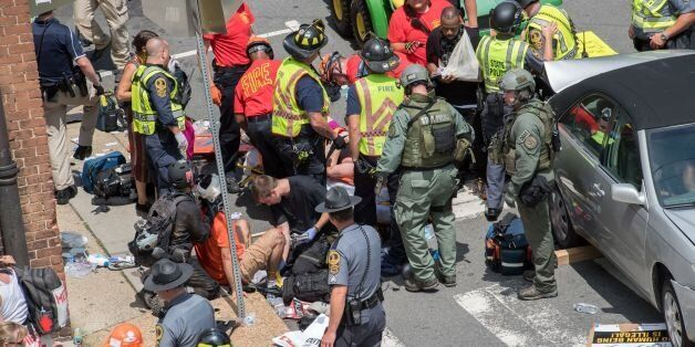 People receive first-aid after a car accident ran into a crowd of protesters in Charlottesville, VA on...