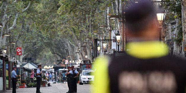 BARCELONA, SPAIN - AUGUST 18: Police officers patrol on Las Ramblas following yesterday's terrorist attack,...