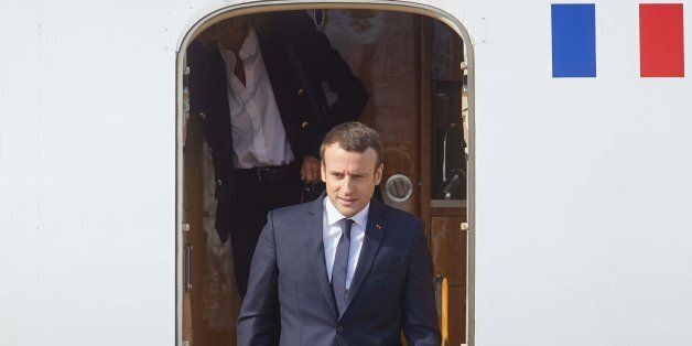 French President Emmanuel Macron disembarks his plane as he arrives to attend the G20 summit in Hamburg,...