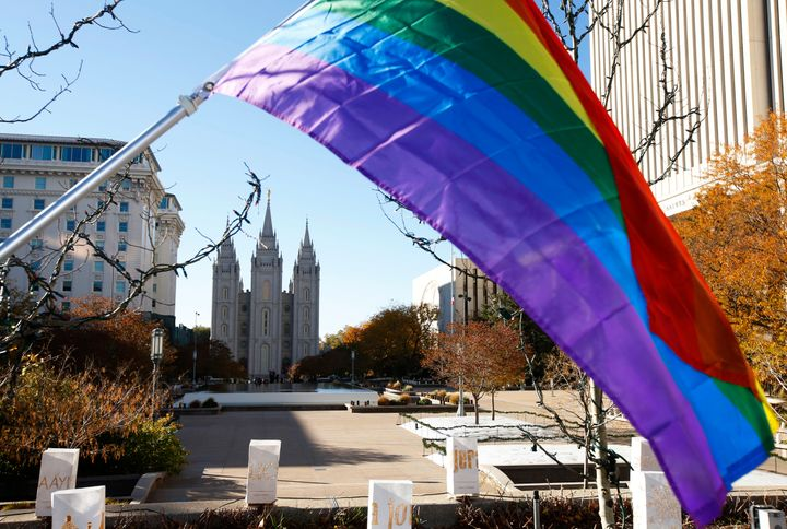 A pride flag flies in front of the Historic Mormon Temple as part of a protest where people resigned from the Church of Jesus