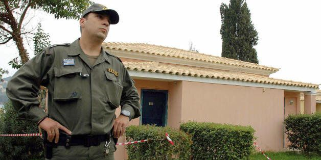 Gouvia, GREECE: A Greek policeman guards the bungalow of the Corcyra hotel where the two British children...