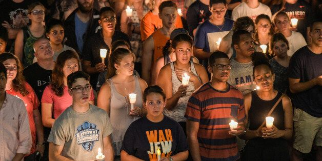 CHARLOTTESVILLE, VA - AUGUST 16: Hundreds of people march peacefully with lit candles across the University...