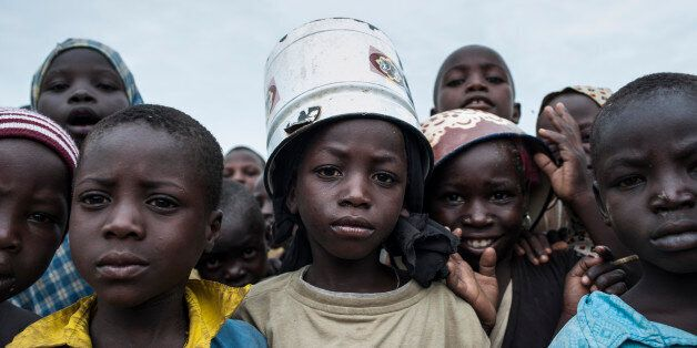 Children pose at one of the Internally-Displaced People (IDP) camps Gwoza, north-eastern Nigeria, on...