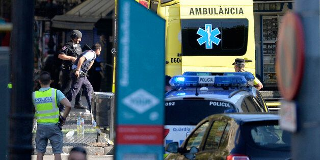 Armed policemen arrive in a cordoned off area after a van ploughed into the crowd, injuring several persons...