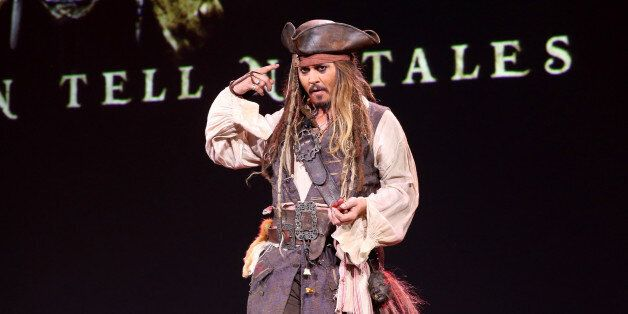 ANAHEIM, CA - AUGUST 15: Actor Johnny Depp, dressed as Captain Jack Sparrow, of PIRATES OF THE CARIBBEAN:...
