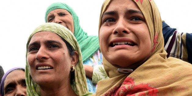 Indian Kashmiri women mourn during the funeral procession for rebel commander of Hizbul Mujahideen Yasin...