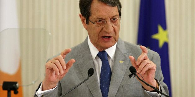Cypriot President Nicos Anastasiades talks during a news conference at the Presidential Palace in Nicosia,...