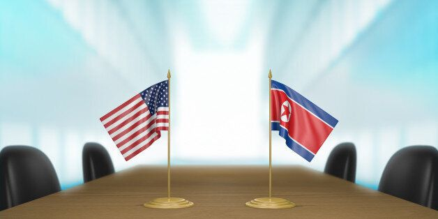 3D rendered scene of miniature flags from the United States and North Korea at a table for diplomatic