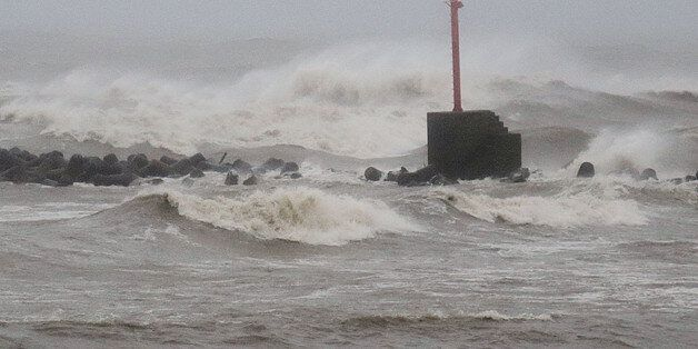 Large waves caused by typhoon Noru are seen at the port in Miyazaki city, Miyazaki prefecture on August...