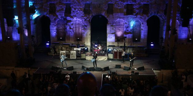 "The American rock band Foo Fighters during concert in the Odeon of Herodes Atticus or Herodeon (built in 161 AD) at the foothills of the Athens Acropolis, as part of PBS's world-renowned documentary series ""Landmarks Live In Concert"" . On July 10, 2027 (Photo by Panayotis Tzamaros/NurPhoto via Getty Images)"