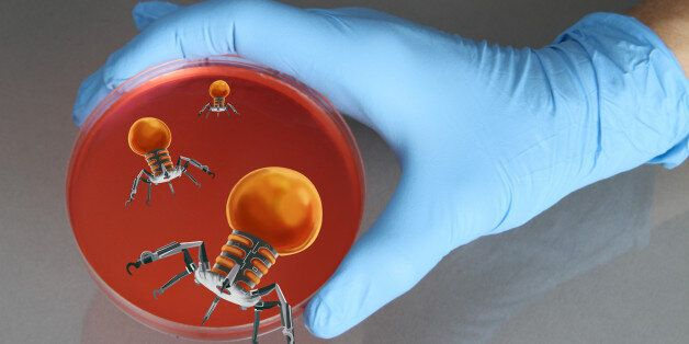 Conceptual illustration of a gloved hand holding a petri dish with nanorobots emerging from the dish....