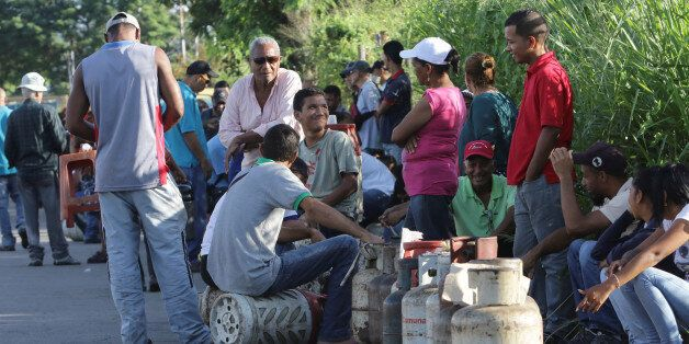 People queue as they try to buy gas cylinders in Puerto Ordaz, Venezuela August 8, 2017. Picture taken...