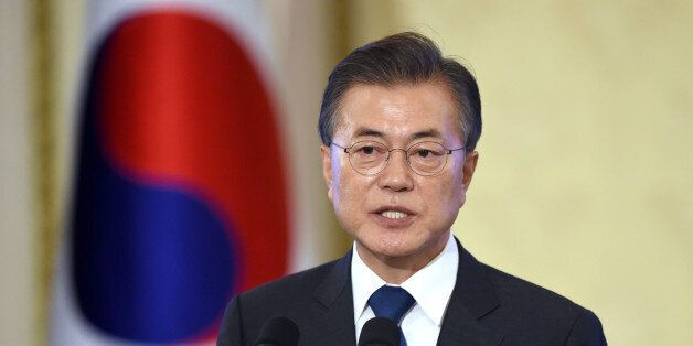 South Korea's President Moon Jae-In speaks during a press conference marking his first 100 days in office...