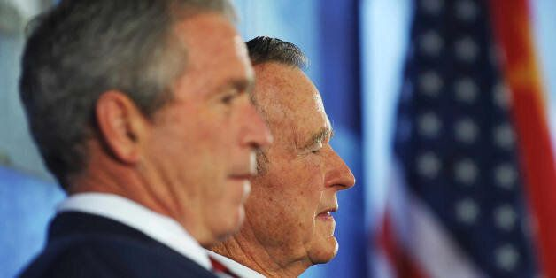 US President George W. Bush (L) and his father George H. W. Bush take part in the dedication ceremony...