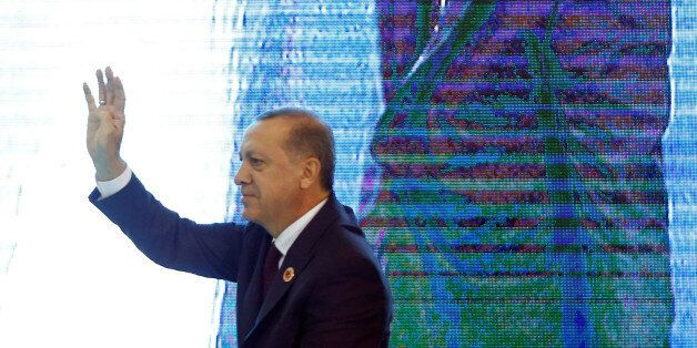 Turkish President Tayyip Erdogan greets the audience during a ceremony to mark the 16th anniversary of...