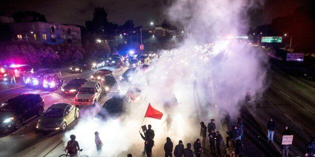 TOPSHOT - Protesters block both directions of the Interstate 580 freeway during a rally against racism...