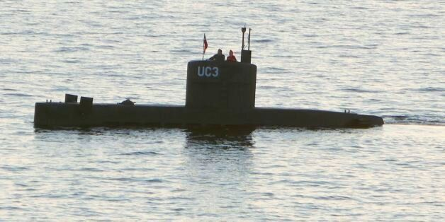 Allegedly Swedish journalist Kim Wall stands next to a man in the tower of the private submarine 'UC3...