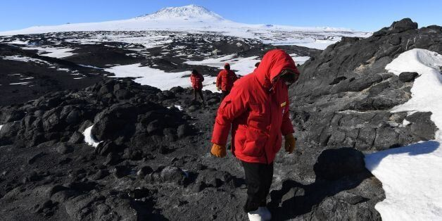 US Secretary of State John Kerry hikes in front of Mount Erebus after visiting the historic Shackleton...