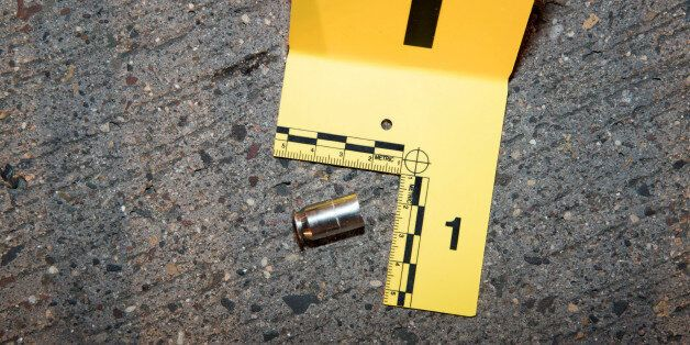 A shell casing from a bullet fired at Philando Castile lies outside his car, in an evidence photo taken...