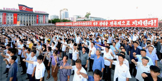 People participate in a Pyongyang city mass rally held at Kim Il Sung Square on August 9, 2017, to fully...