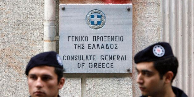 Turkish riot policemen stand guard during a demonstration in front of the Greek consulate in Istanbul...