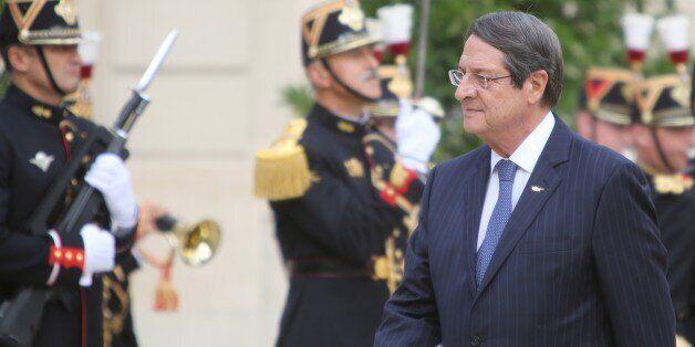PARIS, FRANCE - SEPTEMBER 28: Greek Cypriot Leader Nikos Anastasiadis walks past honor guard during an...