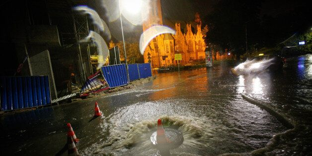 Water from an underground sewage system is seen overflowing onto a public road in the center of the city...