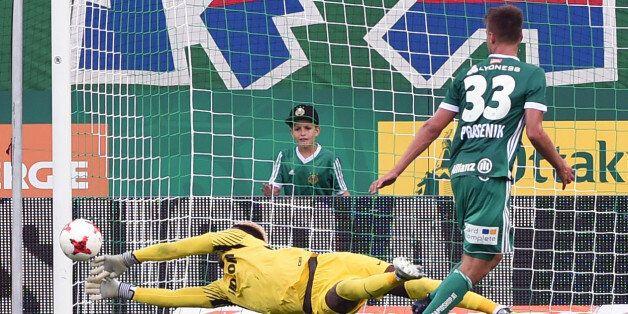 (L-R) Loic Badiashile of AS Monaco vies with Philipp Prosenik of SK Rapid Wien during a friendly football...