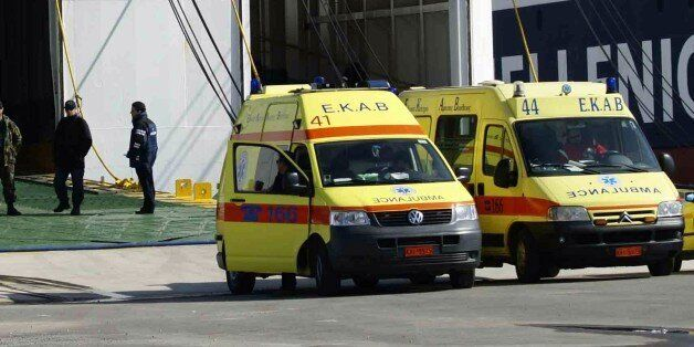 Ambulances are parked in front of the Cypriot-flagged ship Ionian King, which was used to evacuateg 1,280...