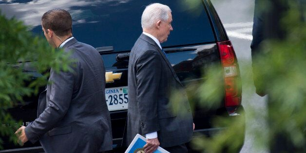 US Attorney General Jeff Sessions leaves the West Wing of the White House in Washington, DC on July 26,...