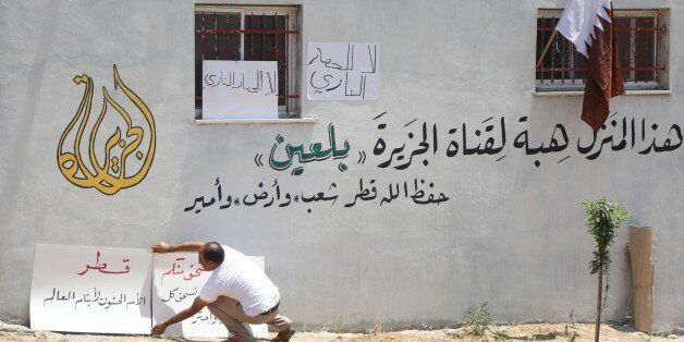 RAMALLAH, WEST BANK - JULY 2: A Palestinian man places placards to the wall of a house after Palestinian...