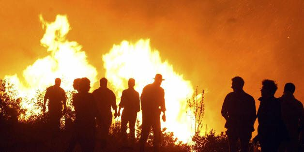 Firefighters try to extinguish a fire close to the Croatian southern Adriatic resort of Dubrovnik, 06...