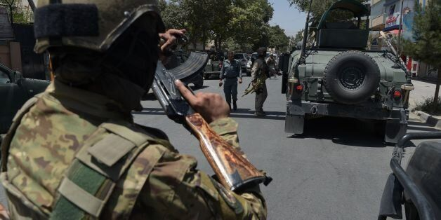 Afghan security arrive at the site of a suicide blast near Iraq's embassy in Kabul on July 31, 2017.A...