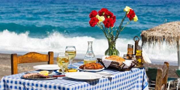 Beautiful romantic table on the beach near the sea