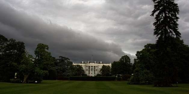 The White House is seen under dark rain clouds in Washington, DC, on June 1, 2015. The national weather...