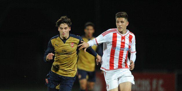 PIRAEUS, GREECE - DECEMBER 09: Savvas Mourgos of Arsenal takes on Retsos Panagiotis of Olympiacos during...