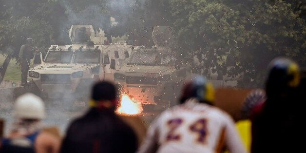 Opposition activists clash with riot police during a protest against President Nicolas Maduro's government...