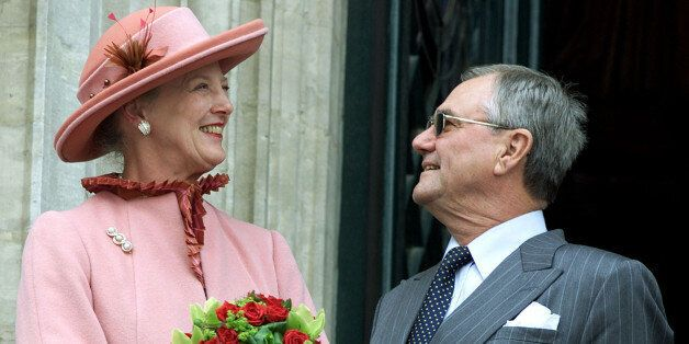 Danish Queen Margrethe smiles to her husband Prince Consort Henrikduring an appearance on the balcony...