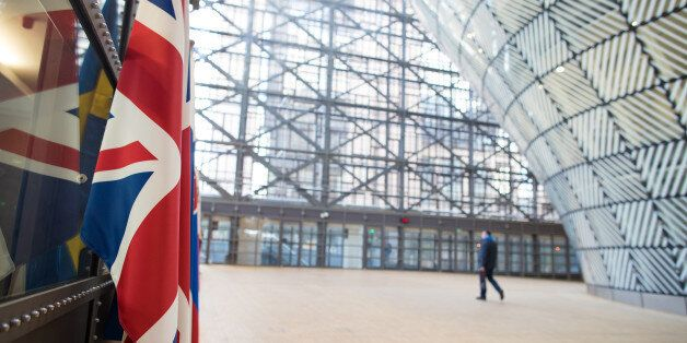 The U.K.'s Union Flag, also known as Union Jack, left, hangs inside the European Union's (EU) new Europa...