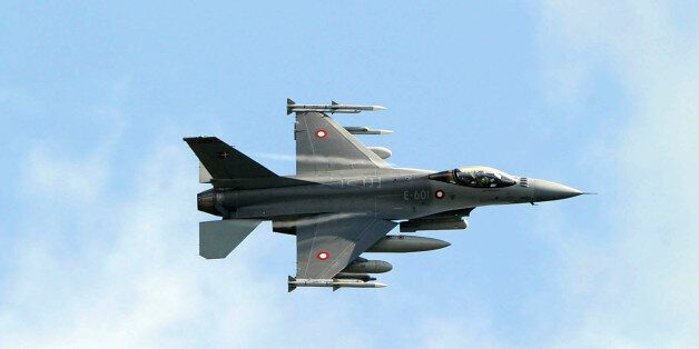 A Danish F-16 Fighting Falcon jet fighter flies over the Sigonella NATO Airbase in the southern Italian...