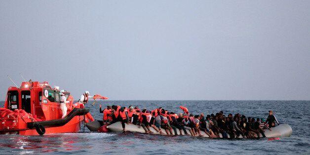 Migrant are seen during rescue operation in the Mediterranea Sea October 20, 2016. Yara Nardi/Italian...
