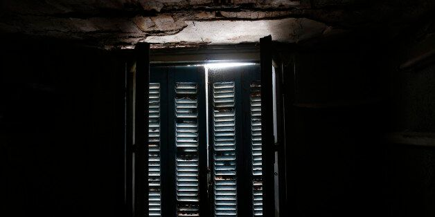 Daylight shines through a closed window at an auxiliary room at