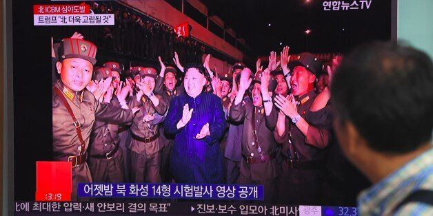 A man watches a television screen showing a video footage of North Korean leader Kim Jong-Un during the...