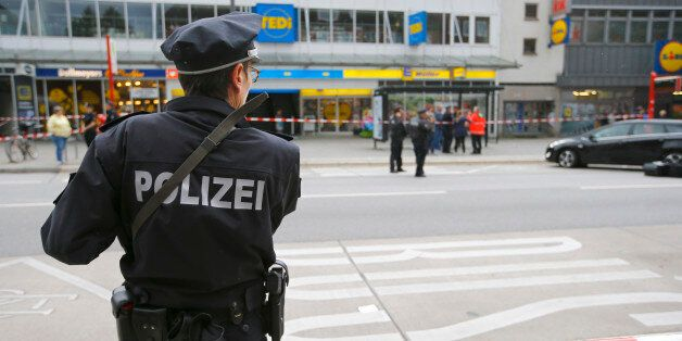 A police officer looks on after a knife attack in a supermarket in Hamburg, Germany, July 28, 2017. REUTERS/Morris...