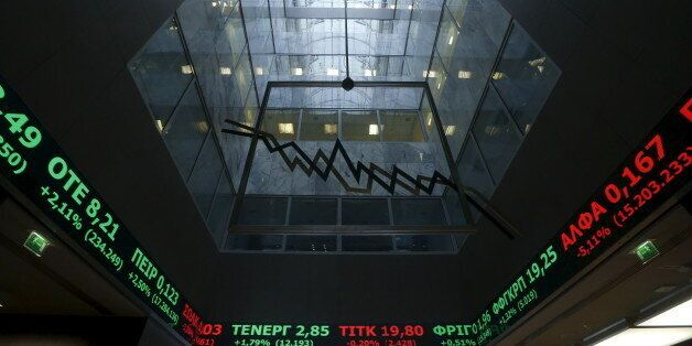 A stock ticker shows stock options inside the Athens stock exchange building in Athens, Greece, September...