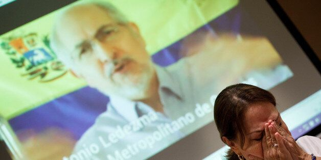 Mitzy Capriles de Ledezma, wife of former Caracas mayor Antonio Ledezma, reacts during a video showing...