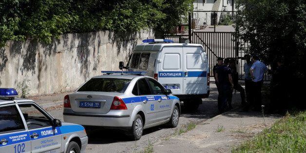 Russian police cars block the entrance to the U.S. embassy warehouse building in the south of Moscow,...